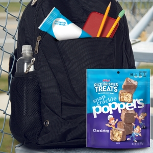 Pack Rice Krispies Treats and Snap Crackle Poppers in backpacks with school supplies