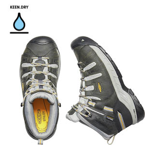 Aerial view of a grey women's work boot with sage accents and a bright yellow sole. Water drop icon