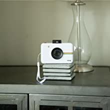 white polaroid snap camera on bricks