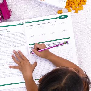 A child working on workbook