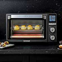 Calphalon Performance Air Fry Oven with doughnut holes baking inside.