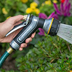 Melnor Nozzle being used to spray a garden