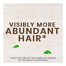 visibly more abundant hair