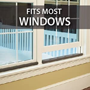 Brown Twin Draft Guard used on two windows overlooking snowy patio.Fits windows and doors.