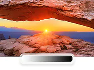 QLED TV with desert sunset scene