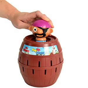 A person Pushing the pirate into the barrel
