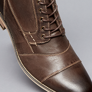 949aff540ff Channel your effortlessly cool vibe with Steve Madden s trendsetting boots  for men. Rock a laid-back masculine look with casual lace-up boots crafted  from ...