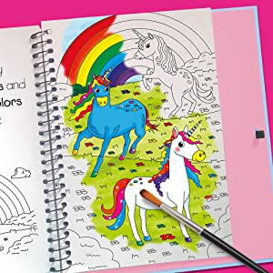 Open book shot of Paint with Water Horses and Unicorns with image partially colored in