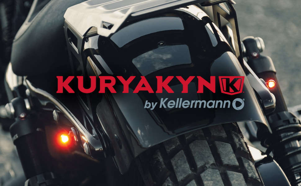 Motorcycle rear close up with LED illumination in red. Reads Kuryakyn by Kellermann.