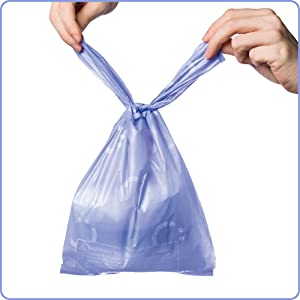 Ubbi diaper sacks are easy to use anywhere. Image of diaper sack being tied shut with ease.