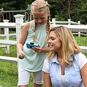 girl showing her mother photo she take with a camera