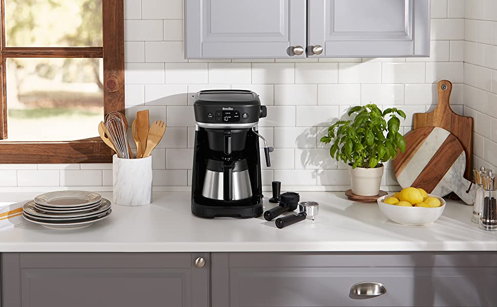 All-in-one Coffee House on kitchen worktop with filter coffee jug plus other attachments