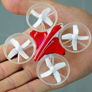 Close up of red Blade Inductrix ultra micro dron in palm of hand to show its small size
