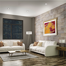 Modern living room with recessed lighting and multiple lamps