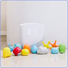 Ubbi bath gift set on bathroom floor with colorful toys lined up in front of the toy drying bin