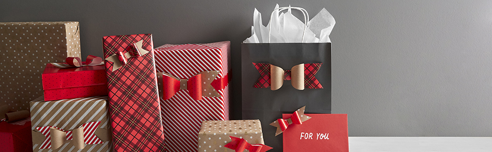 Christmas gift wrap supplies by Hallmark including gift bags with tissue paper, bows & sticker tags