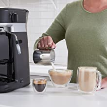 Pouring frothed milk into espresso to create delicious latte