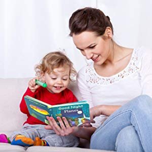 child reading mom baby book