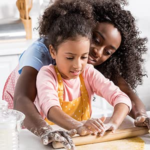 Mother and daughter making gluten free dough