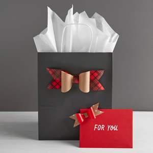 Gray gift bag and red envelope with handmade paper bows made from Hallmark wrapping paper templates