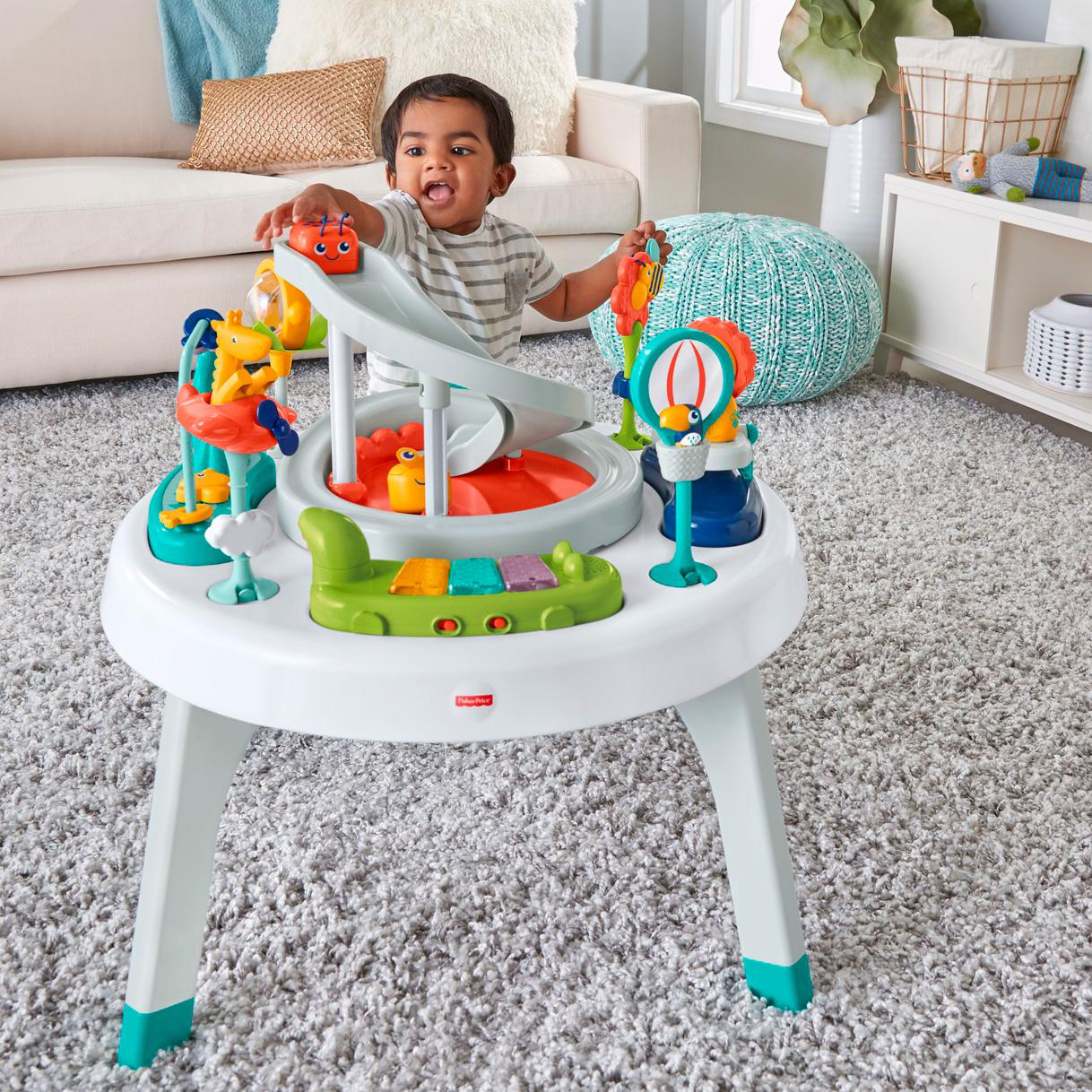 fisher price 2 in 1 sit to stand activity center spin 39 n play safari baby. Black Bedroom Furniture Sets. Home Design Ideas