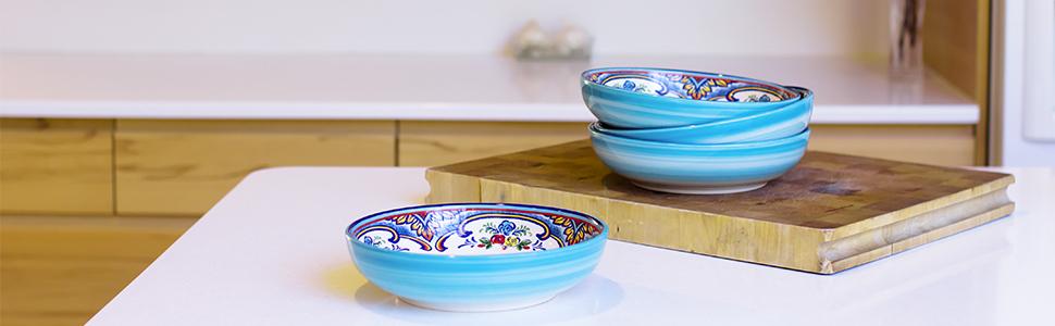 set of 4 zanzibar pasta bowls sitting on a kitchen island and cutting board