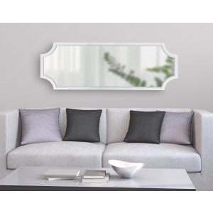 gray mirror over sofa in living room