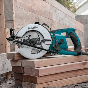 teal and sliver woodworking cutting saw corded power tool beams plywood carpenter