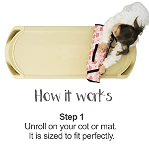toddler girl setting up tot cot nap mat on standard preschool cot