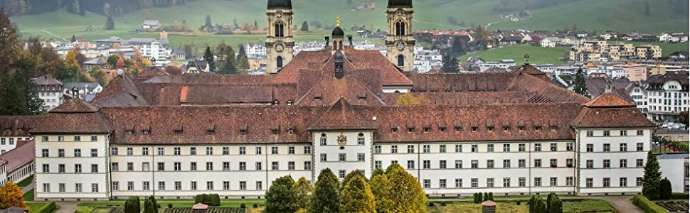 monastery abbey church Einsiedeln St Benedict's statue hillside symmetry buildings