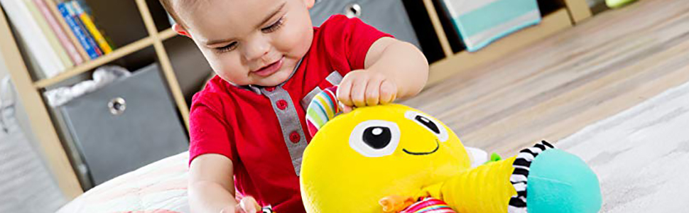 Bbay Playing a Lamaze toy