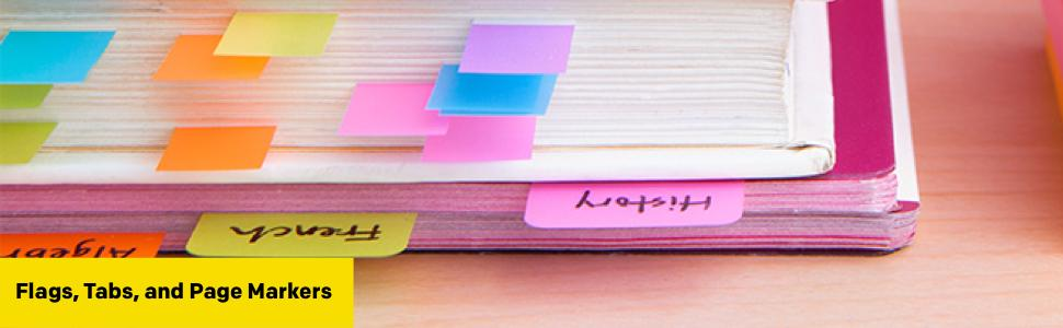 A close on a stack of notebooks with labelled Post-it Markers and coloured Post-it Flags marking s