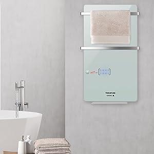 Seca las toallas y calienta tu baño, dos funciones en un solo toallero