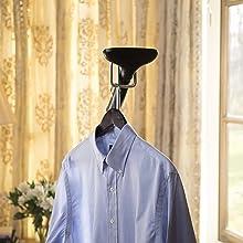 men's blue dress shirt on hanger with steam head