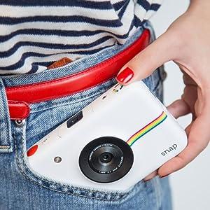 white camera in pocket