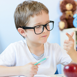 A young boy counting on his fingers
