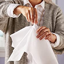 For tissue paper that will stay fluffed in a gift bag, twist center of tissue paper tightly