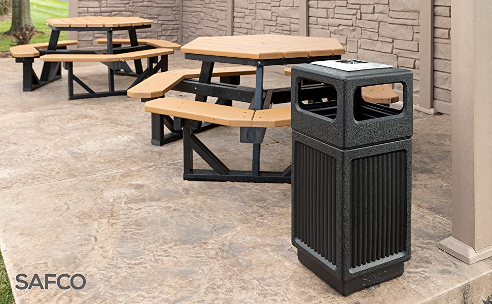 canmeleon trash can on a patio outdoors next to some picnic tables
