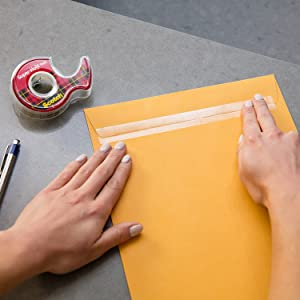 Scotch Super-Hold Tape sealing a large envelope