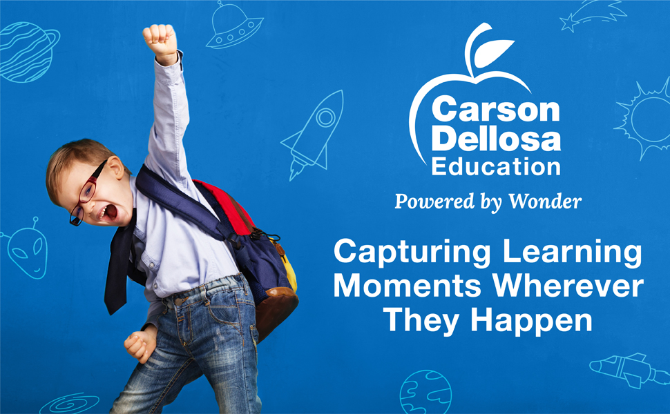 Kindergarten student with his fist in the air in excitement for learning with carson dellosa slogan