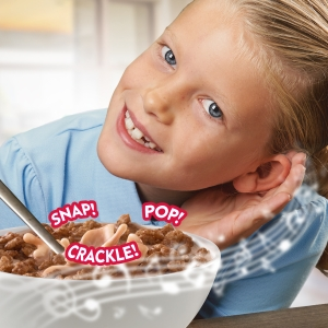 Snap Crackle and Pop make music with milk in a cereal bowl as a little girl listens and smiles