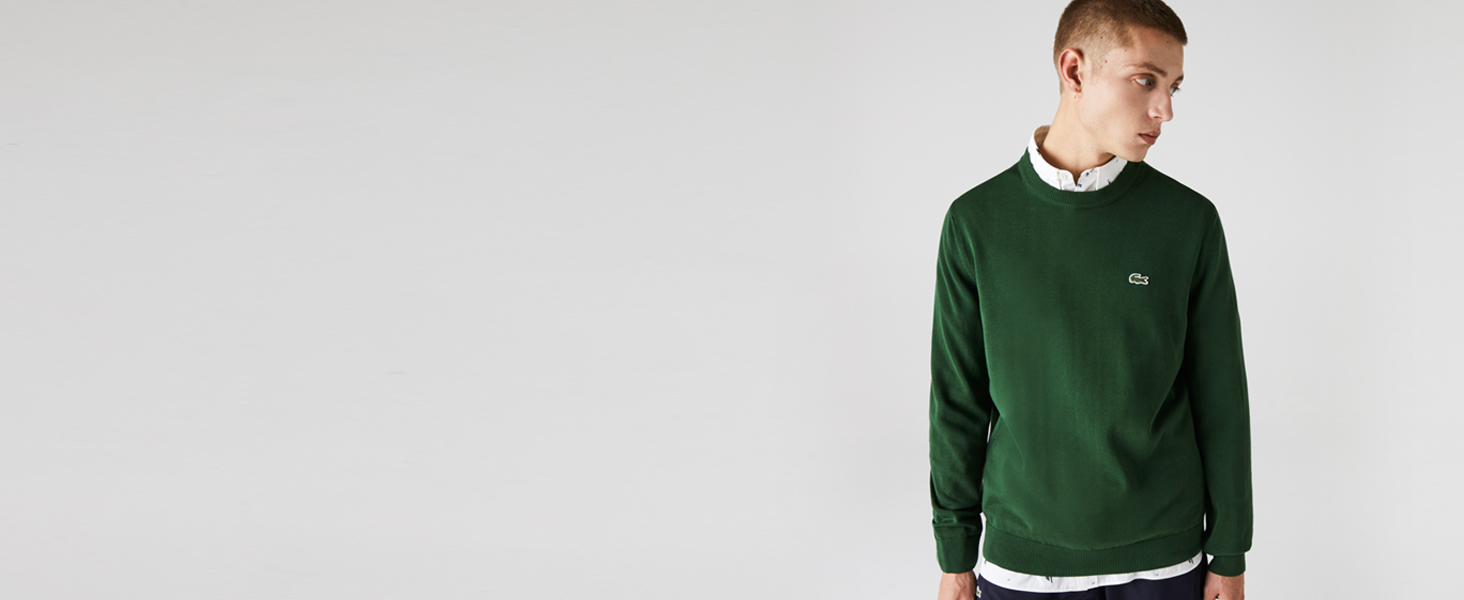 Man in green pullover over a white shirt