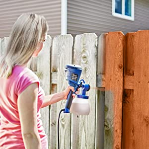 HomeRight Super Finish Max spraying a fence