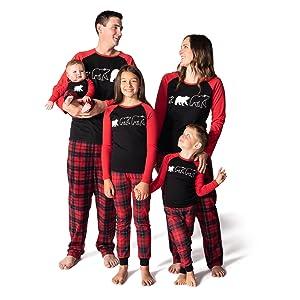 Family wearing matching pajama sets from JumpOff Jo