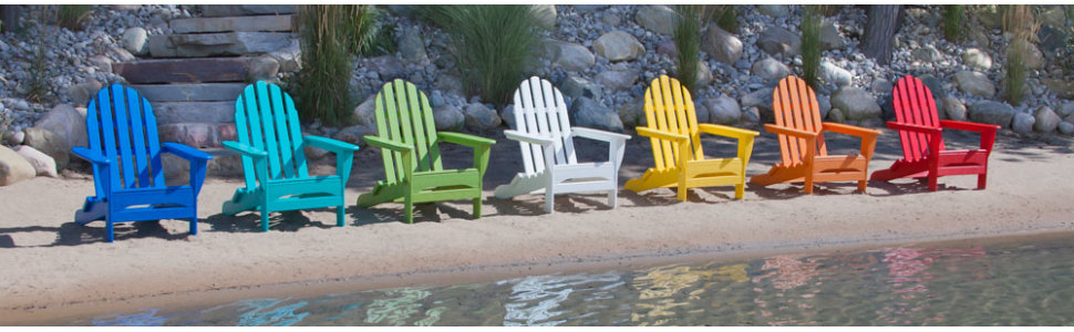 7 colorful adirondack chairs in a row
