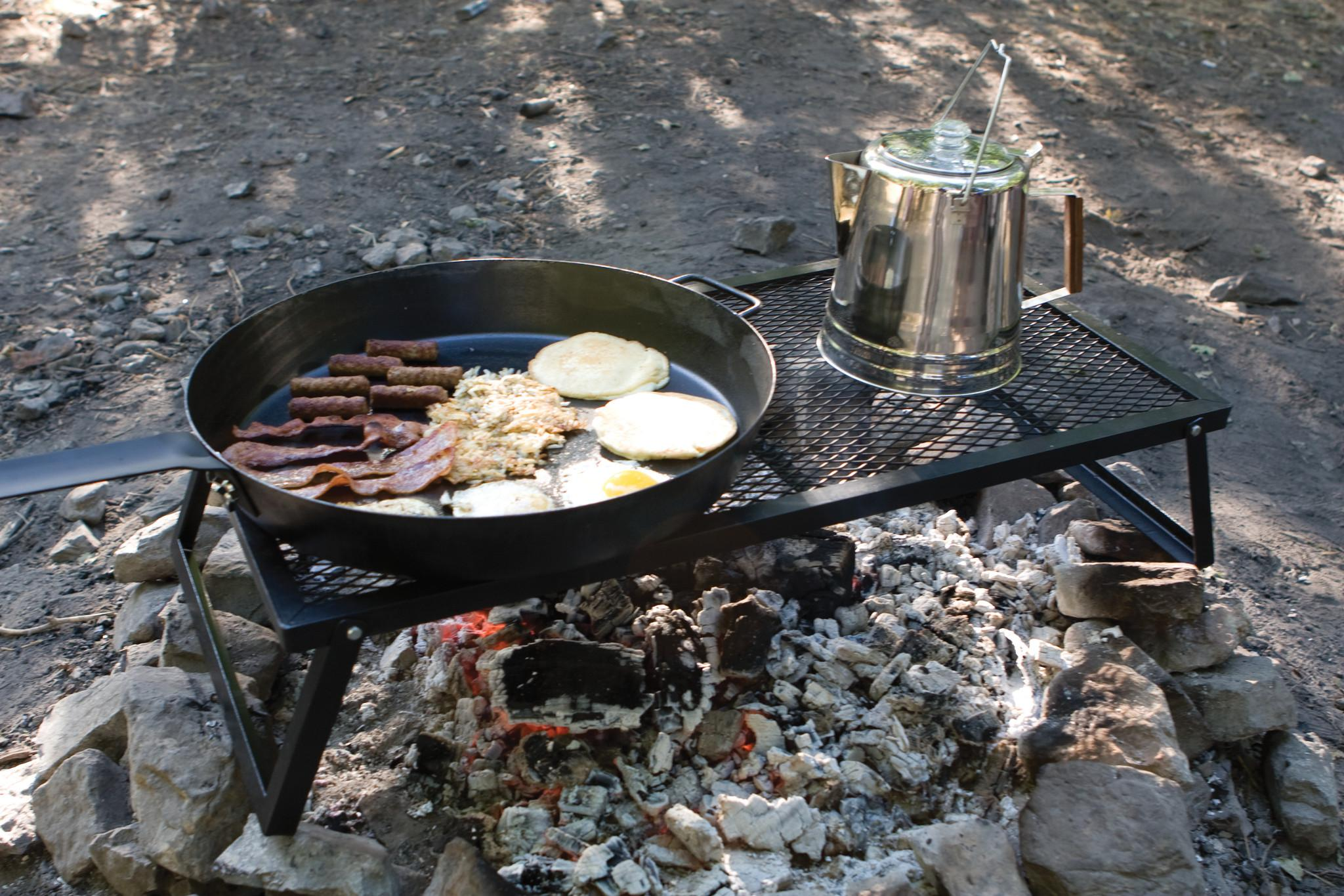 how to cook burgers over teh fire