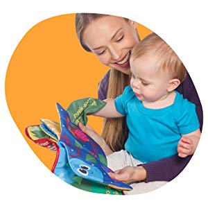 Women showing Lamaze Peek-A-Boo Forest Soft Book to her baby