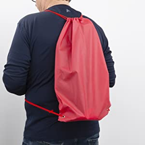 person wearing included red drawstring carrying bag on back with mogo seat inside