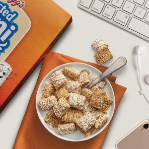 Start your morning with a bowl of Frosted Mini Wheats at your work desk by your computer and phone