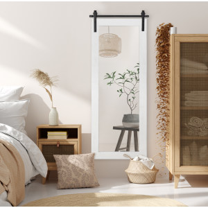 two gold mirrors over lamps in bedroom